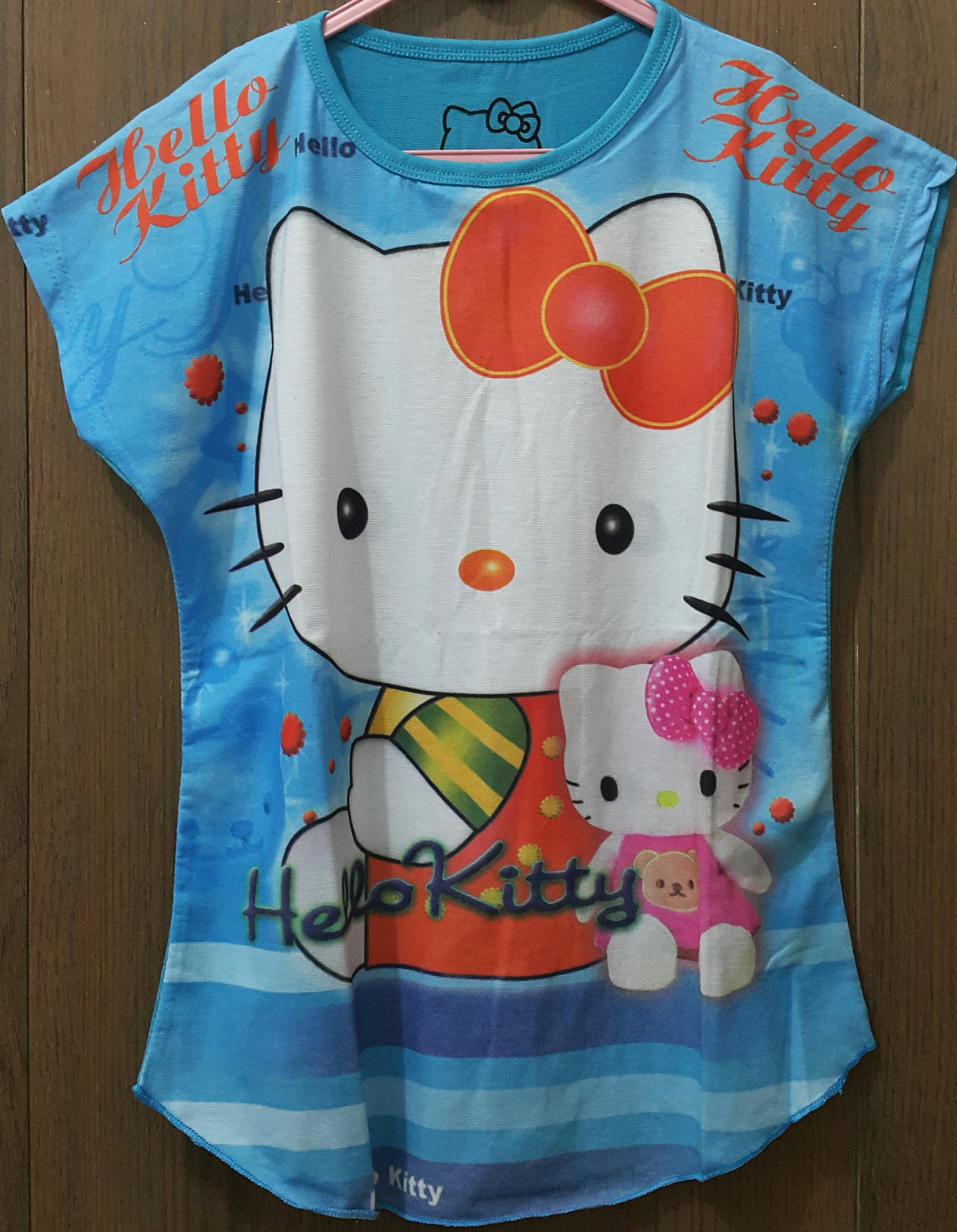 batwing Hello kitty biru boneka